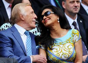 LONDON, ENGLAND - JUNE 26:  Sir Bruce Forsyth and his wife Wilnelia attend the Ladies' Singles second round match between Eugenie Bouchard of Canada and Ana Ivanovic of Serbia on day three of the Wimbledon Lawn Tennis Championships at the All England Lawn Tennis and Croquet Club on June 26, 2013 in London, England.  (Photo by Mike Hewitt/Getty Images)