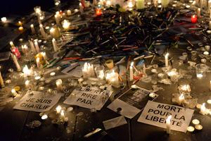 People gather around candles and pens at the Place de la Republique (Republic square) in support of the victims after the terrorist attack earlier today on January 7, 2015 in Paris, France.   (Photo by Aurelien Meunier/Getty Images)