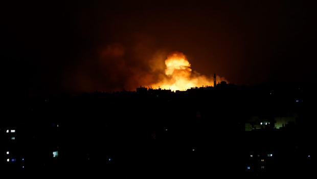 Smoke and flames rise after an Israeli missile strike in Gaza City, in the northern Gaza Strip, Saturday, July 19, 2014.  (AP Photo/Adel Hana)