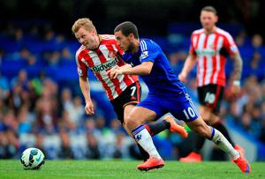 Chelsea's Eden Hazard (right) and Sunderland's Sebastian Larsson in action during the Barclays Premier League match at Stamford Bridge, London. Nick Potts/PA Wire.