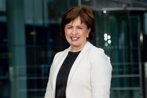 Economy Minister Diane Dodds welcomed the law firm's decision to locate in Belfast.