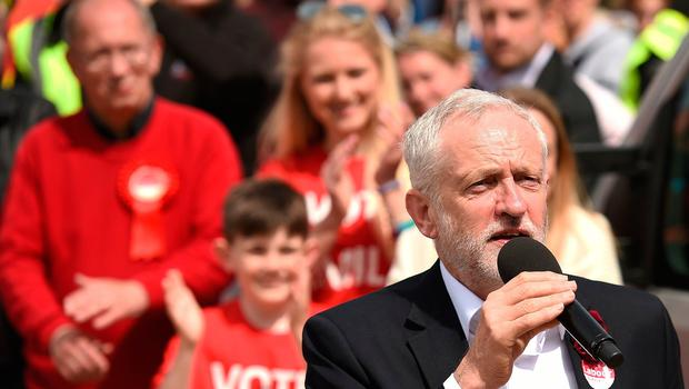 Britain's main opposition Labour Party leader Jeremy Corbyn addresses supporters at a campaign visit in Colwyn Bay, north Wales on June 7, 2017, on the eve of the general election. Britain on Wednesday headed into the final day of campaigning for a general election darkened and dominated by jihadist attacks in two cities, leaving forecasters struggling to predict an outcome on polling day. / AFP PHOTO / Oli SCARFFOLI SCARFF/AFP/Getty Images