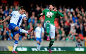 Northern Ireland's Kyle Lafferty (right) battles for the ball with Finland's Niklas Moisander during the UEFA Euro 2016 Qualifier at Windsor Park, Belfast. Martin Rickett/PA Wire.