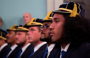 BATH, ENGLAND - SEPTEMBER 15:  Joe Tomone (R) sits with his team mates during the Rugby World Cup 2015 Australia Welcome Ceremony at The Bath Assembly Rooms on September 15, 2015 in Bath, England.  (Photo by Matt Cardy/Getty Images for ER2015)