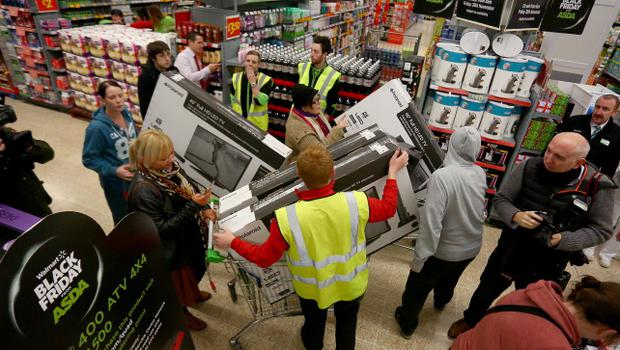 Friday 28th August 2014, Belfast, Northern Ireland - Asda west Belfast Black Friday  Pictured is members of the public rusing into ASDA in west Belfast to purchase items as part of the Black Friday sales across Northern Ireland  Picture Credit : Kevin Scott / Belfast Telegraph
