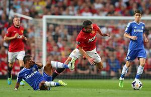 MANCHESTER, ENGLAND - AUGUST 26:  Robin van Persie of Manchester United is tackled by Ashley Cole of Chelsea during the Barclays Premier League match between Manchester United and Chelsea at Old Trafford on August 26, 2013 in Manchester, England.  (Photo by Alex Livesey/Getty Images)