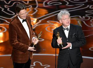 HOLLYWOOD, CA - MARCH 02:  Filmmakers Nicholas Reed (L) and Malcolm Clarke accept the Best Documentary, Short Subject award for 'The Lady In Number 6' onstage during the Oscars at the Dolby Theatre on March 2, 2014 in Hollywood, California.  (Photo by Kevin Winter/Getty Images)