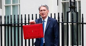 Chancellor Philip Hammond poses for pictures with the Budget Box as he leaves 11 Downing Street before presenting the government's annual Spring budget.