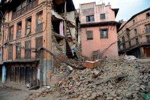 A man walks out of a damaged house in Bhaktapur, on the outskirts of Kathmandu, on April 27, 2015, two days after a 7.8 magnitude earthquake hit Nepal.