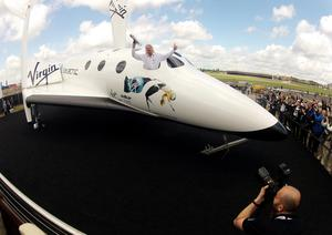 Sir Richard Branson poses on his Virgin Galactic spacecraft (Steve Parsons/PA)