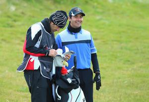 NEWCASTLE, NORTHERN IRELAND - MAY 28:  Felipe Aguilar of Chile looks down the 3rd hole with his caddie during the First Round of the Dubai Duty Free Irish Open Hosted by the Rory Foundation at Royal County Down Golf Club on May 28, 2015 in Newcastle, Northern Ireland.  (Photo by Andrew Redington/Getty Images)