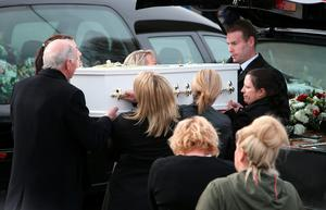Louise James (right) who lost her partner, two sons, sister and mother carries a coffin out of the Holy Family church, Ballymagroarty in Londonderry after the funeral of the five people who were killed when their car slid off a slipway in Co Donegal. PRESS ASSOCIATION Photo. Picture date: Thursday March 24, 2016. Sean McGrotty and his sons Mark, 12, and Evan, eight, died along with his mother-in-law Ruth Daniels, 57, and her 14-year-old daughter Jodie Lee Daniels after their SUV sank after sliding off the pier slipway in Buncrana, Co Donegal. See PA story FUNERAL Pier. Photo credit should read: Brian Lawless/PA Wire