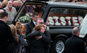 Mourners outside the Holy Family church, Ballymagroarty in Londonderry after the funeral of the five people who were  killed when their car slid off a slipway in Co Donegal. PRESS ASSOCIATION Photo. Picture date: Thursday March 24, 2016. Sean McGrotty and his sons Mark, 12, and Evan, eight, died along with his mother-in-law Ruth Daniels, 57, and her 14-year-old daughter Jodie Lee Daniels after their SUV sank after sliding off the pier slipway in Buncrana, Co Donegal. See PA story FUNERAL Pier. Photo credit should read: Brian Lawless/PA Wire