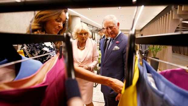 Charles and Camilla talk to British Fashion Council chief executive Caroline Rush (Henry Nicholls/PA)
