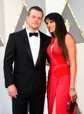 Actor Matt Damon (L) and Luciana Barroso arrive on the red carpet for the 88th Oscars on February 28, 2016 in Hollywood, California. AFP PHOTO / VALERIE MACONVALERIE MACON/AFP/Getty Images