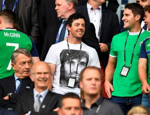 PARIS, FRANCE - JUNE 21: Rory McIlroy watches on from the stands during the UEFA EURO 2016 Group C match between Northern Ireland and Germany at Parc des Princes on June 21, 2016 in Paris, France. (Photo by Charles McQuillan/Getty Images)