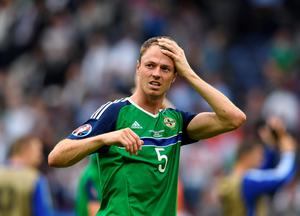 PARIS, FRANCE - JUNE 21: Jonny Evans of Northern Ireland after the UEFA EURO 2016 Group C match between Northern Ireland and Germany at Parc des Princes on June 21, 2016 in Paris, France. (Photo by Charles McQuillan/Getty Images)
