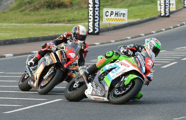 James Hillier (Quattro Plant JG Speedfit Kawasaki) and Michael Rutter (Bathams Racing BMW) during a race at the Vauxhall International North West 200 in Portrush.  Photo by David Maginnis/Pacemaker Press