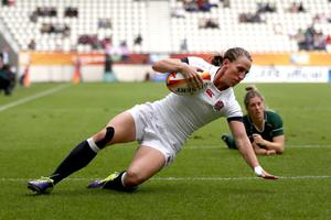 Feeling down: Katherine Merchant of England touches down a try during yesterday's World Cup semi-final in Paris