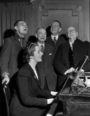 FILE - APRIL 8: Lord Bell, spokesperson for Baroness Margaret Thatcher, announced in a statement that the former British Prime Minister died peacefully following a stroke aged 87.   circa 1950:  Conservative candidate Margaret Roberts accompanies four voters on the piano in a sing-song after a brief political argument in the bar of The Bull Inn, Dartford.  (Margaret Roberts married Denis Thatcher and went on to become Prime Minister.)  (Photo by Keystone/Getty Images)