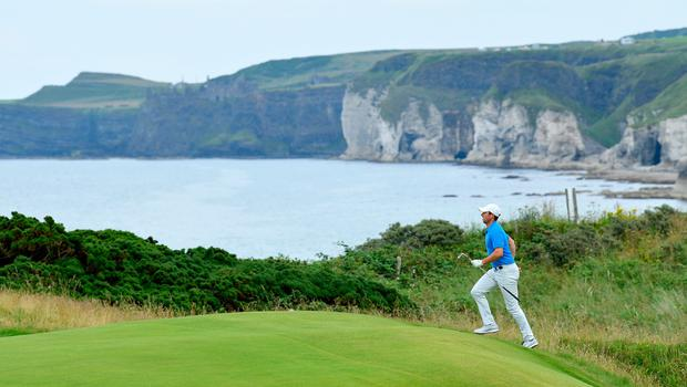 PORTRUSH, NORTHERN IRELAND - JULY 16: Rory McIlroy of Northern Ireland walks during a practice round prior to the 148th Open Championship held on the Dunluce Links at Royal Portrush Golf Club on July 16, 2019 in Portrush, United Kingdom. (Photo by Stuart Franklin/Getty Images)