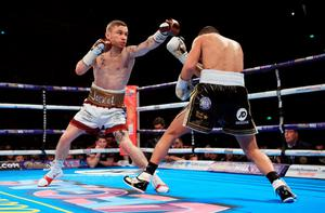 Carl Frampton (left) and Scott Quigg during their IBF & WBA World Super-Bantamweight Championship bout at Manchester Arena.