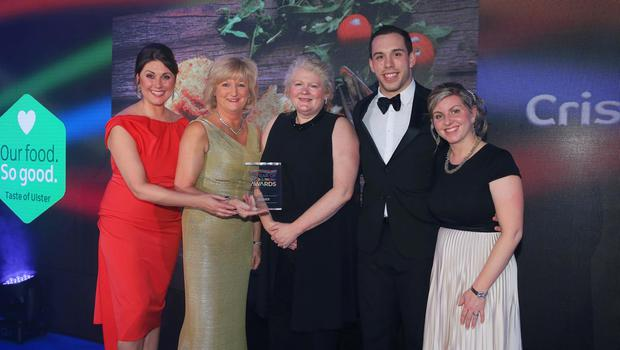 Press Eye - Belfast - Northern Ireland - 2nd February 2017 -    NI Year of Food & Drink Awards at the Culloden Hotel.  Award 2 Food Innovation  Sarah Travers, host of the NI Year of Food & Drink Awards is pictured with Michele Shirlow from Food NI, presenting Mash Direct with the award for Food Innovation for their Crispy Vegetable Bakes. The inaugural awards celebrated the collaborative efforts of all from the food, drink and hospitality industry during the NI Year of Food & Drink 2016, with an gala awards evening at the Culloden Hotel.  Pictured left to right: Sarah Travers, Tracey Hamilton, Michele Shirlow from Food NI, Tim Acheson and Clare Forster.  Photo by Kelvin Boyes / Press Eye.