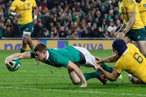 Australia's flanker Dean Mumm (R) cannot prevent Ireland's centre Garry Ringrose diving over the line to score Ireland's second try during the rugby union test match between Ireland and Australia at the Aviva stadium in Dublin on November 26, 2016. / AFP PHOTO / PAUL FAITHPAUL FAITH/AFP/Getty Images