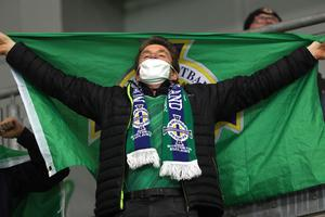 PACEMAKER, BELFAST, 8/10/2020: Northern Ireland fan sings during the European Championship qualifying play-off against Slovakia at the National stadium in Belfast.  PICTURE BY STEPHEN DAVISON