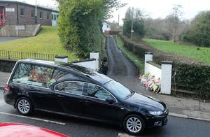 Press Eye - Belfast - Northern Ireland - 1st February 2018  Funeral service held for 64-year-old Robert Flowerday in Crumlin, Co. Antrim.  The retired teacher was found in his Crumlin home last week after being murdered during a burglary.  Mr Flowerday's coffin passes by his home after the funeral service in Crumlin Presbyterian Church.   Picture by Jonathan Porter/PressEye