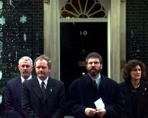 File photo dated 11/12/97 of Sinn Fein president Gerry Adams and his deputy Martin McGuinness (left) with party aides outside No10 Downing Street before meeting Prime Minister Tony Blair for peace talks.  Adam Butler/PA Wire