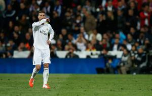 Sergio Ramos of Real Madrid leaves the field after being shown the red card during the La Liga match between Real Madrid CF and FC Barcelona at the Bernabeu on March 23, 2014 in Madrid, Spain.  (Photo by Gonzalo Arroyo Moreno/Getty Images)