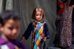 An Iraqi girl, whose family fled the city of Ramadi after it was seized by Islamic State (IS) group militants, looks on outside a tent at a camp housing displaced families on May 18, 2015 in Bzeibez, on the southwestern frontier of Baghdad with Anbar province. Shiite militias converged on Ramadi in a bid to recapture it from jihadists who dealt the Iraqi government a stinging blow by overrunning the city in a deadly three-day blitz. AFP PHOTO / AHMAD AL-RUBAYEAHMAD AL-RUBAYE/AFP/Getty Images
