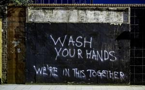 Graffiti on the walls at freedom corner in east Belfast as COVID-19 claims a third life in Northern Ireland on March 23rd 2020 (Photo by Kevin Scott for Belfast Telegraph)