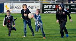 Having a ball: Kilcoo kids take to the Pairc Esler pitch on Sunday during half-time in the Down champions' Ulster semi-final win over Maghery