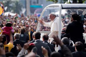 RIO DE JANEIRO, BRAZIL - JULY 28:  Pope Francis waves from the Popemobile as he heads to celebrate Mass on Copacabana Beach during World Youth Day celebrations on July 28, 2013 in Rio de Janeiro, Brazil. Millions of pilgrims are expected to join the pontiff for his visit to the Catholic Church's World Youth Day celebrations which is running July 23-28. (Photo by Buda Mendes/Getty Images)