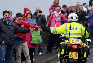 The Giro d'Italia passes Dunluce Castle, one of Northern Ireland's most scenic routes. About 200 cyclists set off from Belfast to travel along the north coast before returning to the city.