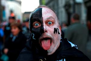 A New Zealand fan with face paint during the Rugby World Cup match at the Millennium Stadium, Cardiff. PRESS ASSOCIATION Photo. Picture date: Friday October 2, 2015. See PA story RUGBYU New Zealand. Photo credit should read: David Davies/PA Wire. RESTRICTIONS: Use subject to restrictions. Editorial use only. No commercial use. No use in books or print sales without prior permission. Call +44 (0)1158 447447 for further information.