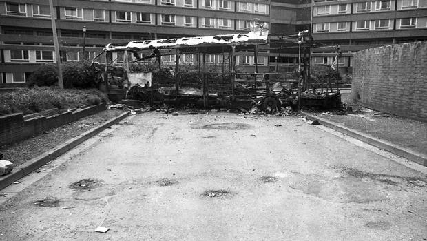 I was fascinated by this burnt-out shell of a bus effectively jamming an access road to the Divis Flats. My father was a bus driver and I was curious to see what the bus was made of  its interesting that the steel frame is left while the body, which is aluminium and plastic, has burned away.