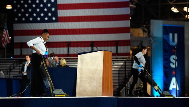 Workers vacuum the stage at the Jacob K. Javits Convention Center in New York on November 8, 2016 where Democratic presidential candidate Hillary Clinton's election night event is held. AFP/Getty Images