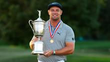 Shock success: Bryson DeChambeau gets to grips with the US Open trophy