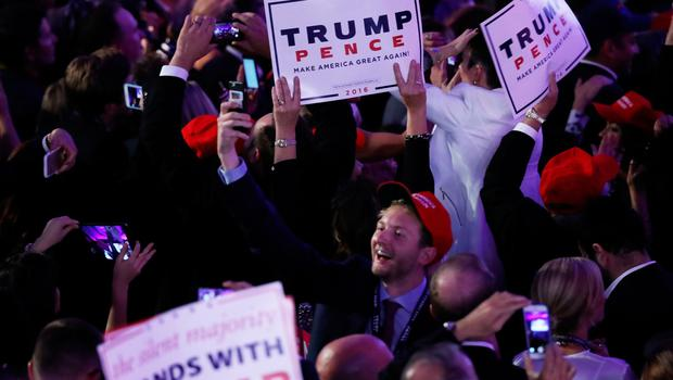 NEW YORK, NY - NOVEMBER 09:  People celebrate during the call for Republican president-elect Donald Trump at his election night event at the New York Hilton Midtown on November 9, 2016 in New York City. at the New York Hilton Midtown in the early morning hours of November 9, 2016 in New York City. Donald Trump defeated Democratic presidential nominee Hillary Clinton to become the 45th president of the United States.  (Photo by Joe Raedle/Getty Images)