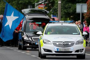 The flag of St Mary's College in Rathmines is carried during the funeral of Niccolai Schuster at The Church of the Three Patrons in Rathgar, Dublin. PRESS ASSOCIATION Photo. Picture date: Wednesday June 24, 2015. He died when a balcony collapsed in the college town of Berkeley, California. See PA story FUNERAL Balcony. Photo credit should read: Niall Carson/PA Wire