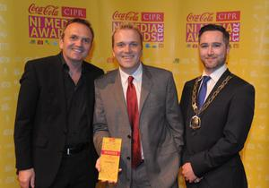 Sports Journalist of the Year Paul Ferguson (centre) accepts his award from Geoff Hayhurst, Paradox Omega Sports (left) and Gary McKeown, CIPR