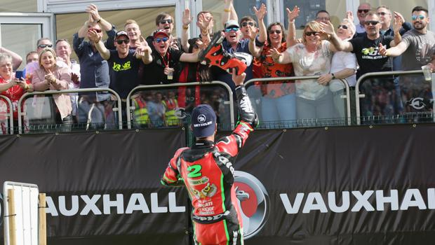 PACEMAKER BELFAST  19/05/2018 North West 200 2018 Glenn Irwin celebrates victory in todays Merrow Hotel & Spa NW 200 Superbike race by launching his boots into the crowd of fans in the Vauxhall International North West 200. Photo Stephen Davison/Pacemaker Press