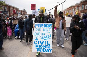 Demonstrators march through the streets protesting the death Freddie Gray, an African American man who died of spinal cord injuries in police custody, Maryland, April 25, 2015. Organizers anticipated the biggest outpouring of public anger since Gray, 25, was arrested on April 12.       AFP PHOTO/JIM WATSONJIM WATSON/AFP/Getty Images