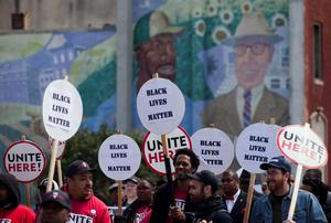 Protesters march during a rally in Baltimore, Maryland, on April 25, 2015, against the death of Freddie Gray while in police custody. Organizers anticipated the biggest outpouring of public anger since Gray, 25, was arrested on April 12, only to die in a coma seven days later from severe spinal injuries.   AFP PHOTO / ANDREW CABALLERO-REYNOLDSAndrew Caballero-Reynolds/AFP/Getty Images