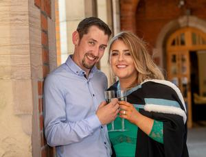 """It was double celebrations today for Queen's University graduate Stephanie Kirwan when her boyfriend of six years proposed just after her graduation ceremony.   Stephanie, who is from Crossmaglen, graduated with a degree in Criminology and Social Policy from the School of School of Social Sciences, Education and Social Work at Queen's University.  Donal Begley, also from Crossmaglen, got down on one knee to pop the question at the graduation garden party and Stephanie's fellow graduates cheered when she accepted the proposal.   Stephanie said: """"I am absolutely ecstatic and completely shocked and overwhelmed. It is so surreal and is an extra special day for me – one that I will never forget.""""  Donal commented: """"I had planned the engagement for around four months as I didn't want to interfere with her studies, I knew she would be looking up wedding venues straight away! I just thought today was a perfect time for me to propose as it is such a special occasion for Stephanie."""""""