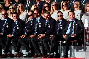 CHASKA, MN - SEPTEMBER 29: Matt Kuchar, Patrick Reed, Zach Johnson, Dustin Johnson, J.B. Holmes, Rickie Fowler and captain Davis Love III of the United States look on during the 2016 Ryder Cup Opening Ceremony at Hazeltine National Golf Club on September 29, 2016 in Chaska, Minnesota.  (Photo by Sam Greenwood/Getty Images)