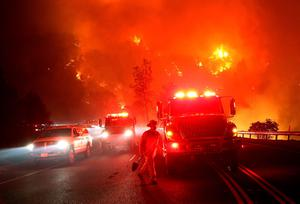 CLEARLAKE, CA - AUGUST 02:  Cal Fire firefighters battle the Rocky Fire on August 2, 2015 near Clearlake, California. Over 1,900 firefighters are battling the Rocky Fire that burned over 22,000 acres since it started on Wednesday afternoon. The fire is currently five percent contained and has destroyed at least 14 homes.  (Photo by Justin Sullivan/Getty Images)